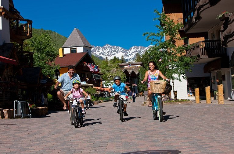 Family biking through Vail Village