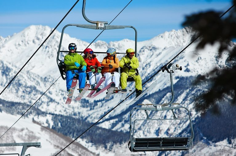 Skiers on lift to ski Vail Mountain