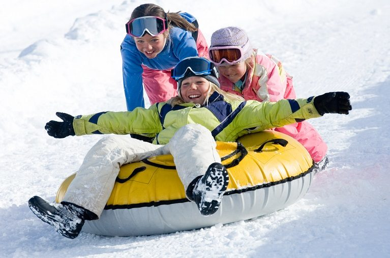 Children snow tubing in Vail